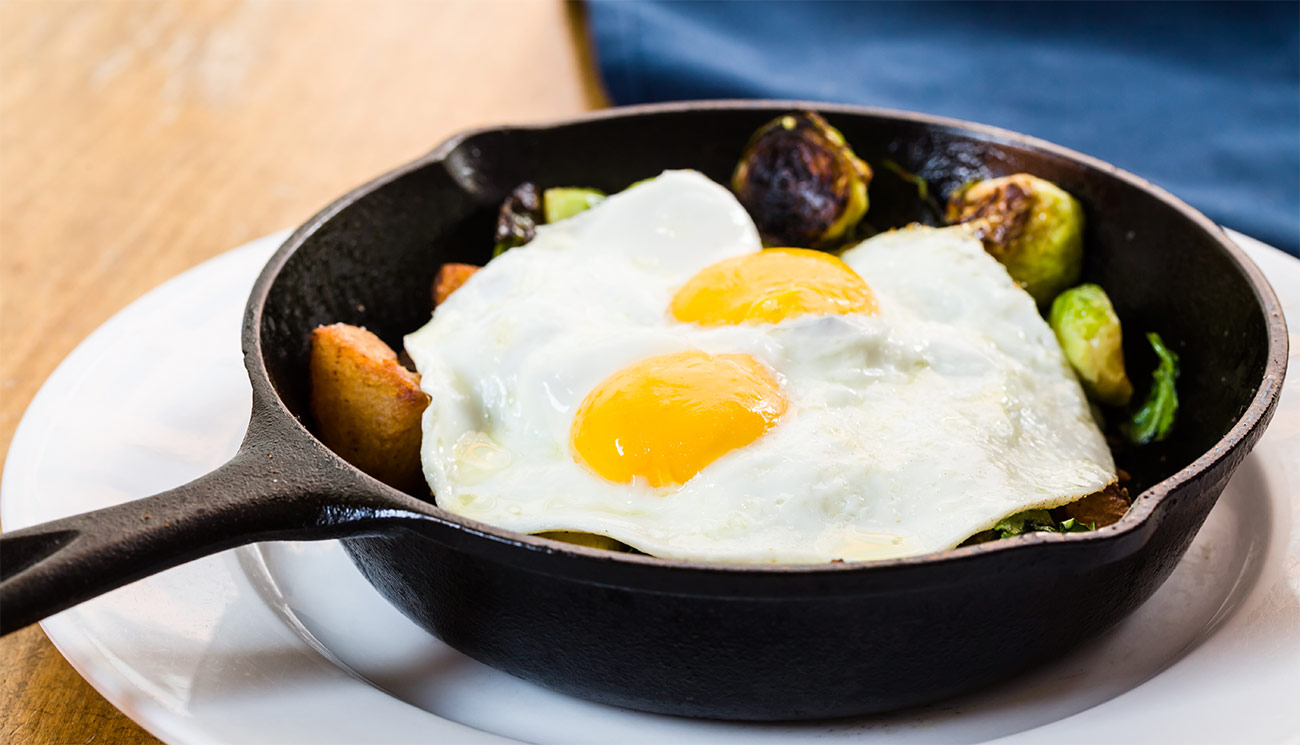 Veggie hash - sunny eggs, brussels sprouts, spinach, onion & potatoes.